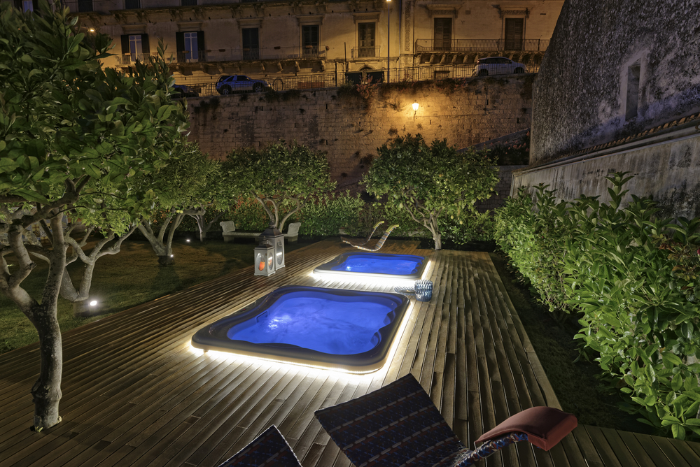Italy, Sicily, Modica (Ragusa Province), whirlpools in a garden at night
