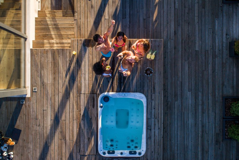 Group of friends having fun on a penthouse terrace, view from above